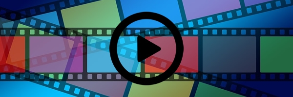 multi-colored frames of film overlaid with play button